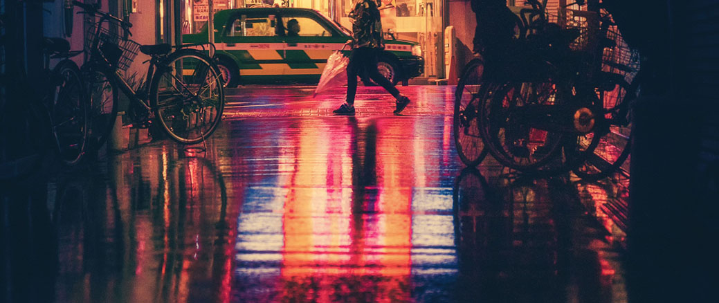 Person walking at night in neon street