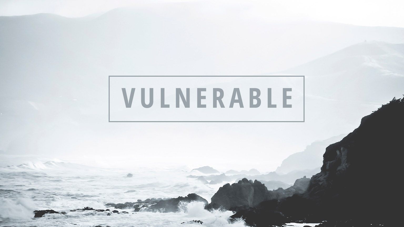 Vulnerable cover - foggy sky over ocean with waves breaking on cliffs